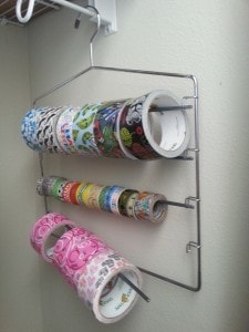 Store your duct tape on a swing arm slack rack